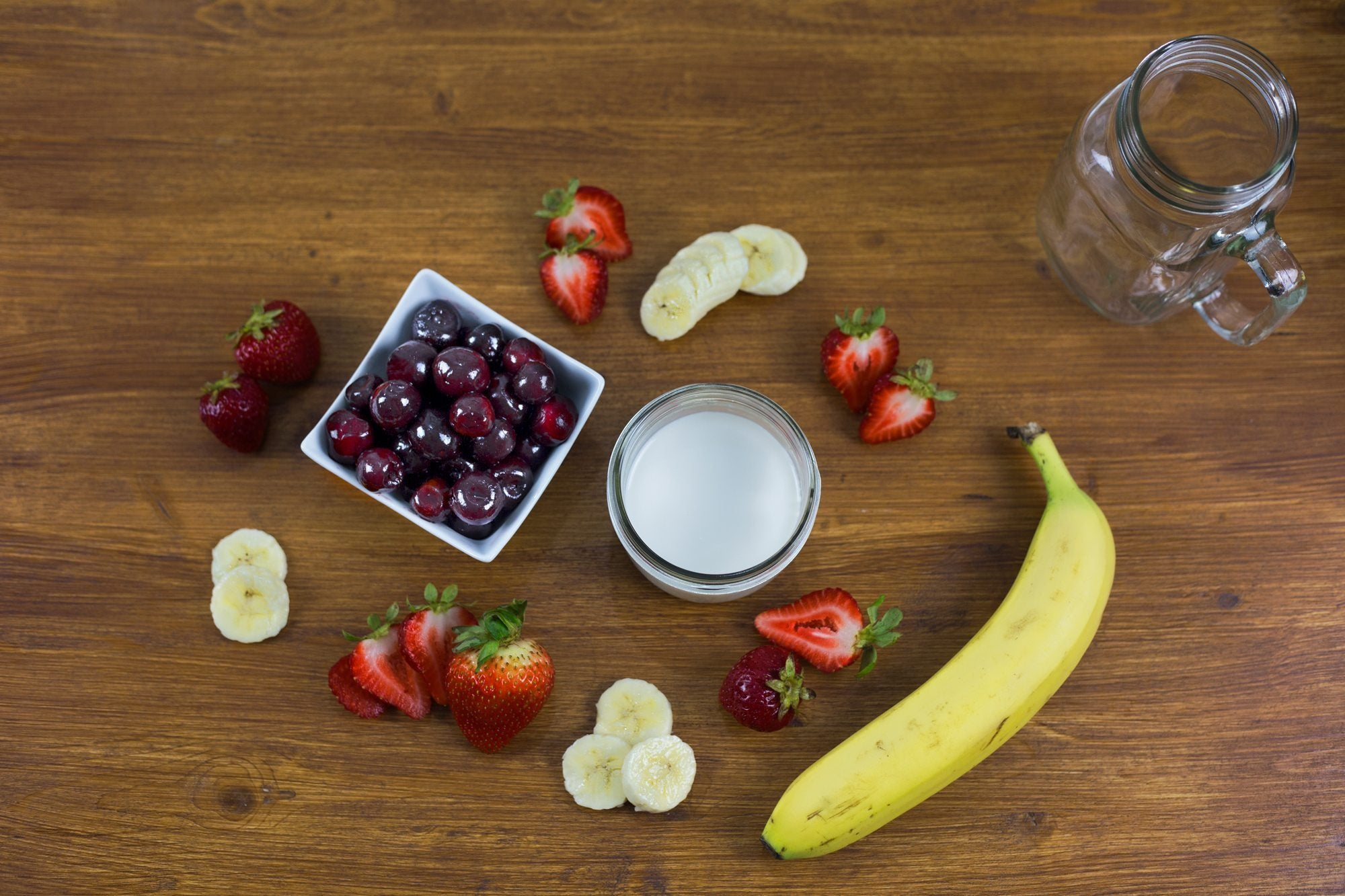 all the ingredients for the gout cherry smoothie laid out| cherries and tart cherry juice and gout