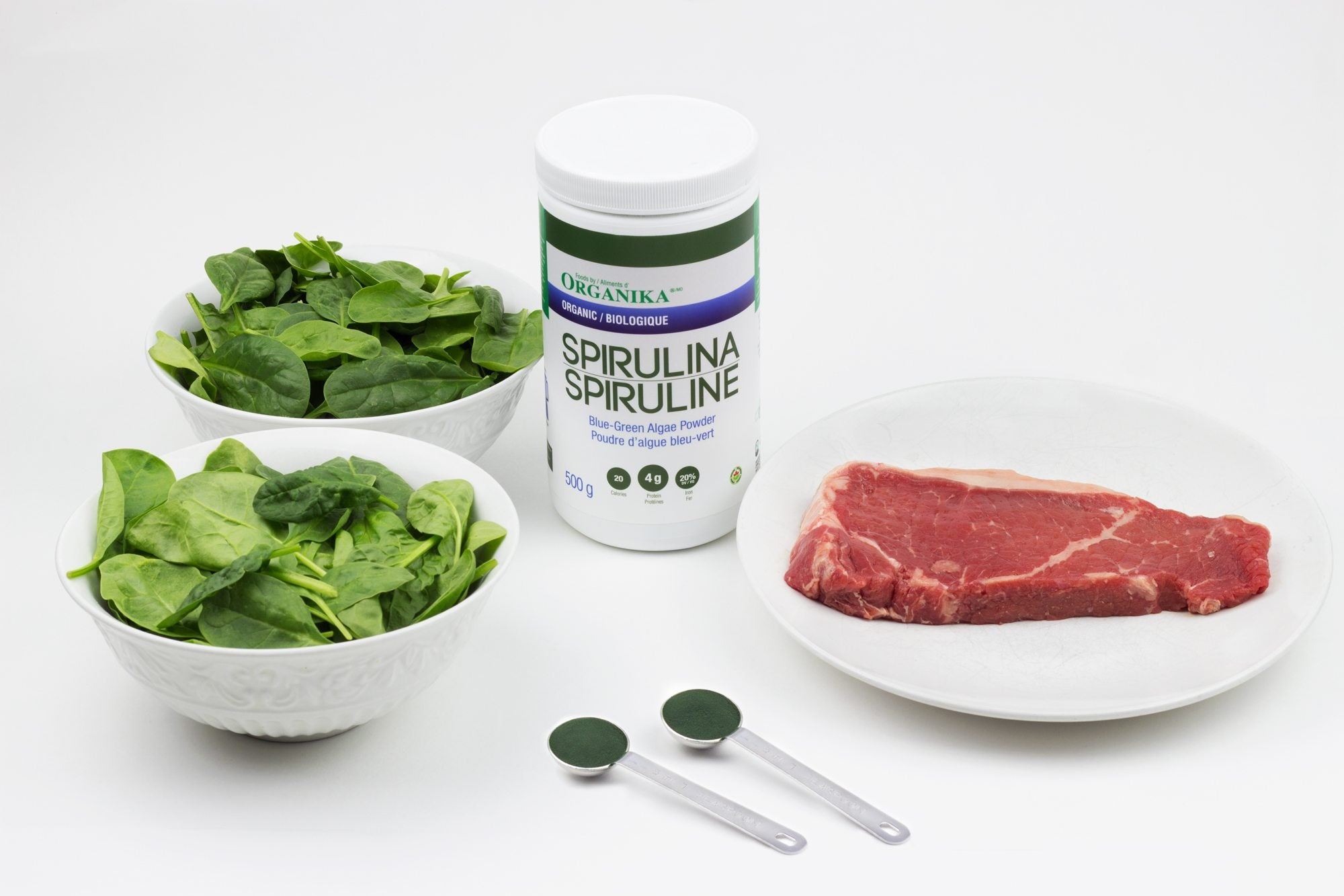 the benefits of spirulina include iron content, providing more than both spinach and steak by weight