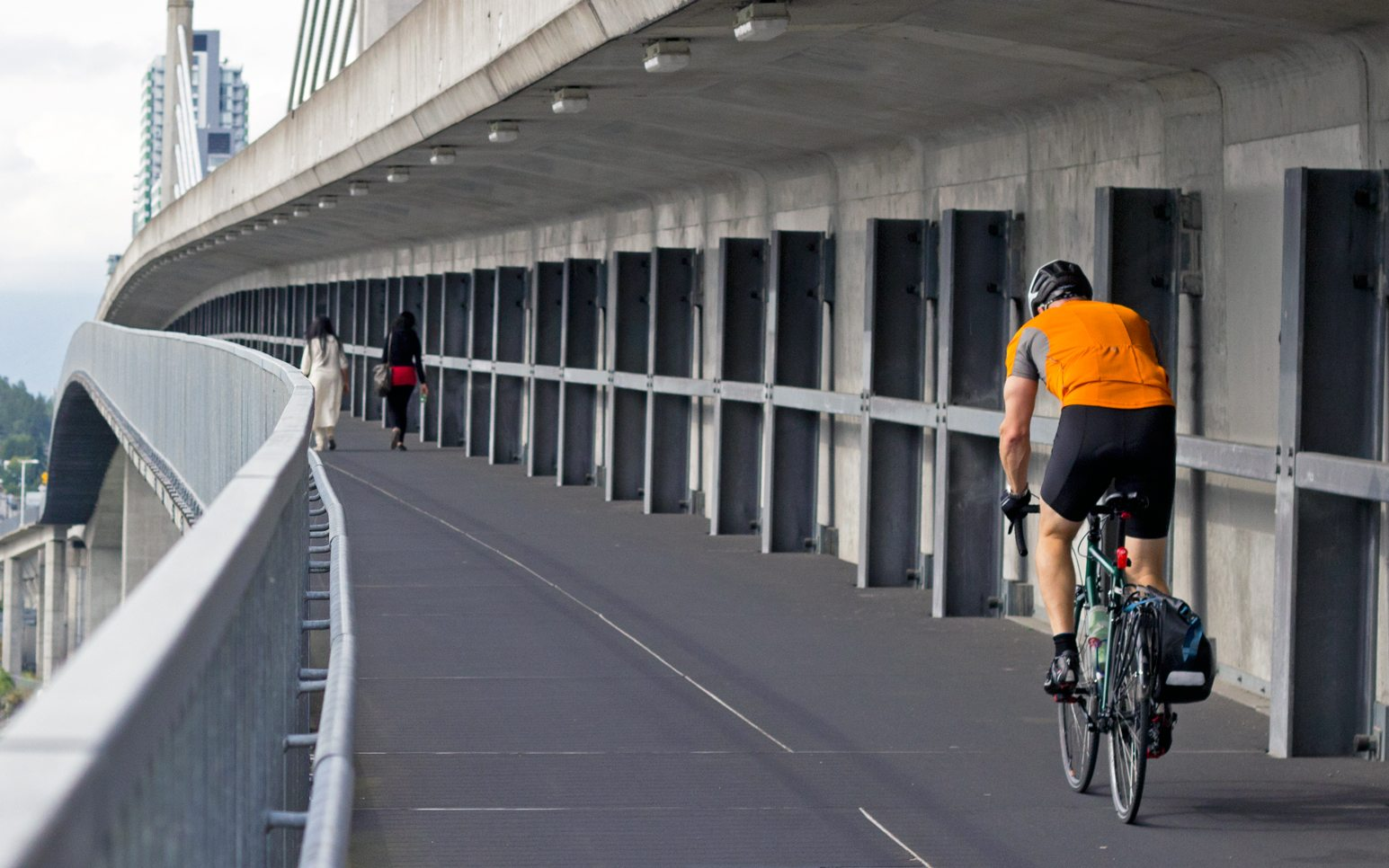 Man biking to work - exercise is an important element of managing high cholesterol levels