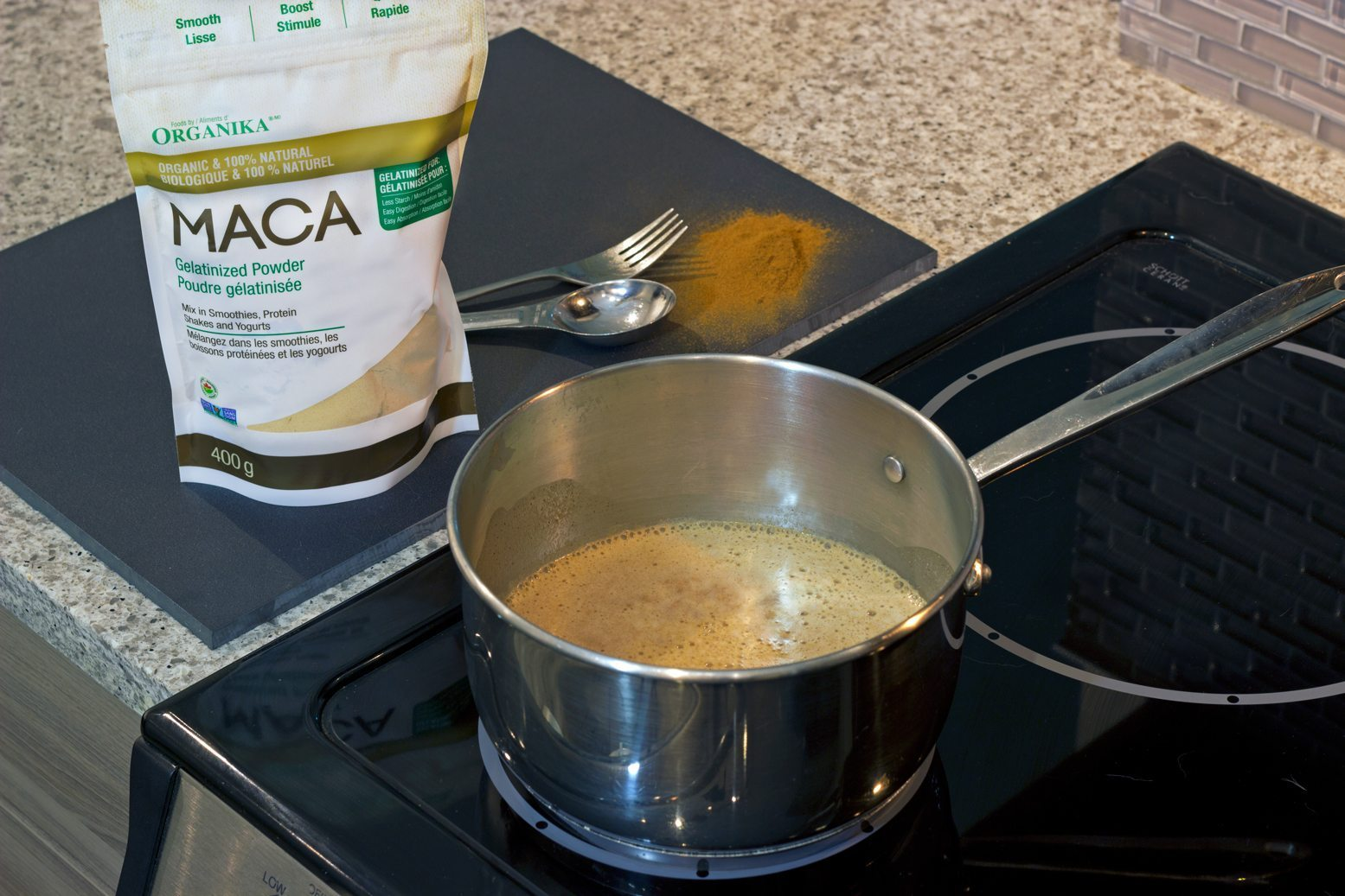 maca powder latte cooking on the stove