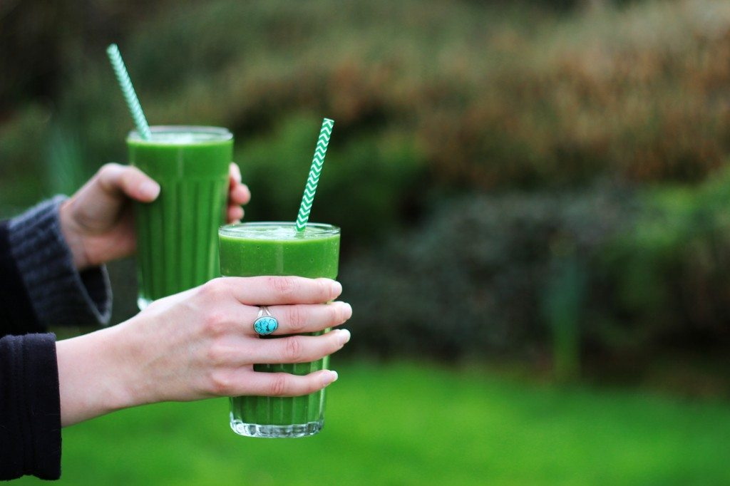 Two Green Smoothies in hand