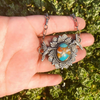 turquoise pendant with silver cast hummingbirds