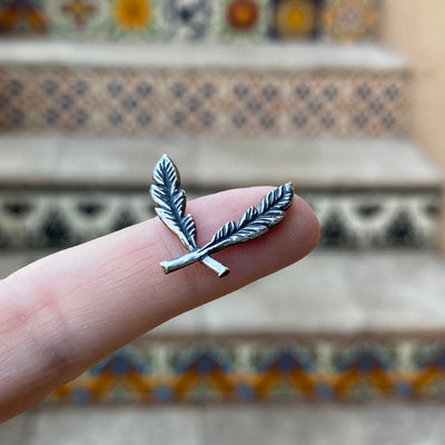 silver feather cabochon border with patina on finger