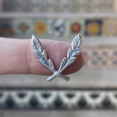 sterling silver feather border casting on finger