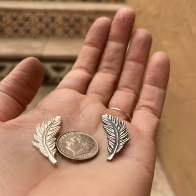 sterling silver feather casting with dime for size reference