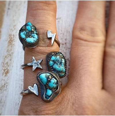 3 turquoise rings with cast lightning bolt, star and heart