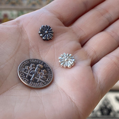 cast silver flower with dime for size reference