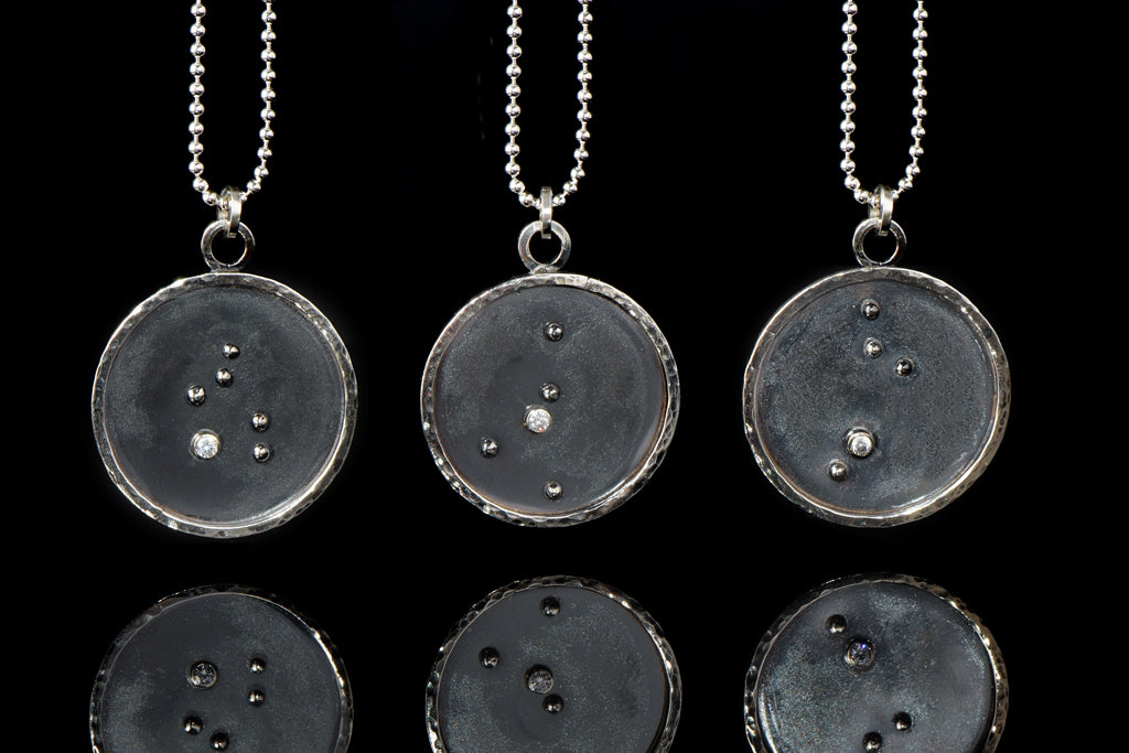 Zodiac necklaces on chain.