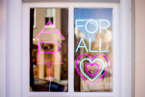 Art for all sign in the window at Miller Gallery