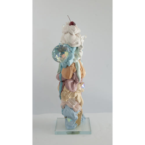 A towering, shiny cupcake sculpture by Olivia Bonilla. Made of cement, resin, and hand cut glass diamonds.
