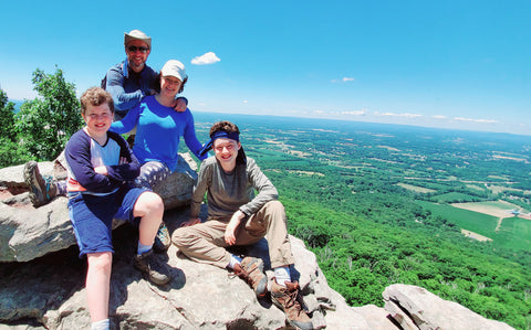 Greskovich family hiking with cooling towels