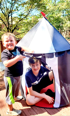 Cooper and Jamie in the play tent