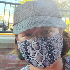 Melanie wearing MMG's snakeskin 2-ply (3-ply with filter) mask