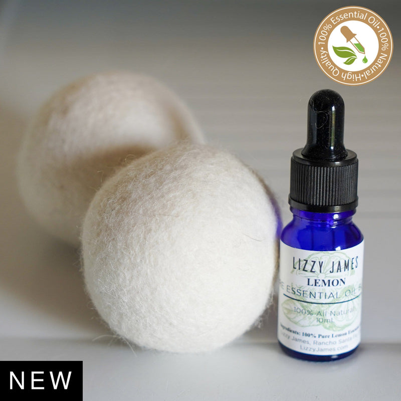 2 wool dryer balls + 1 - 10 ml 100% Pure Lemon Essential Oil bottle.