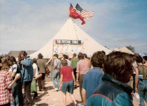 Glastonbury CND Festival 1984, End of World Sale with Pete Drummonds flags flying high.