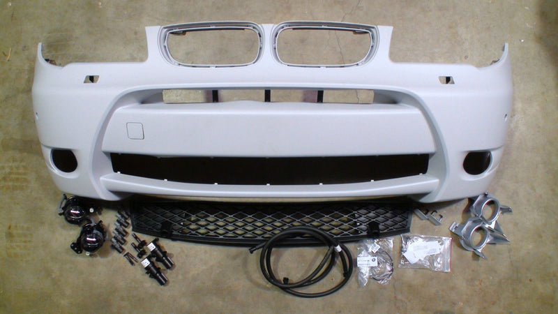 Genuine BMW Aerodynamic Kit Front Bumper Primed X3 E83 with PDC and Headlight Cleaning
