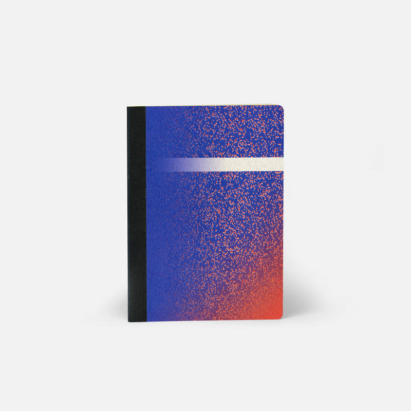 a5 galileo notebook from papier tigre, blue and red speckled cover