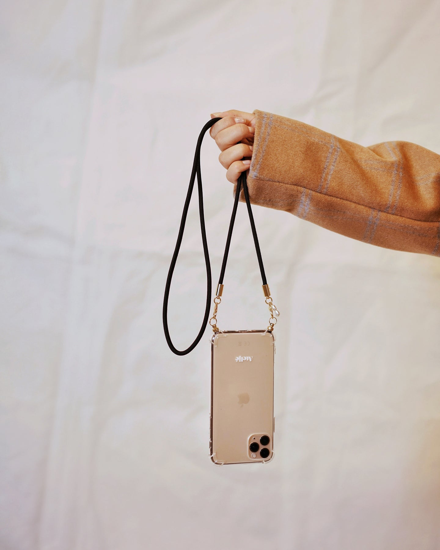 Phone case with recycled black cord