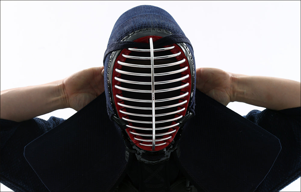 Image of Kendo player wearing Men properly
