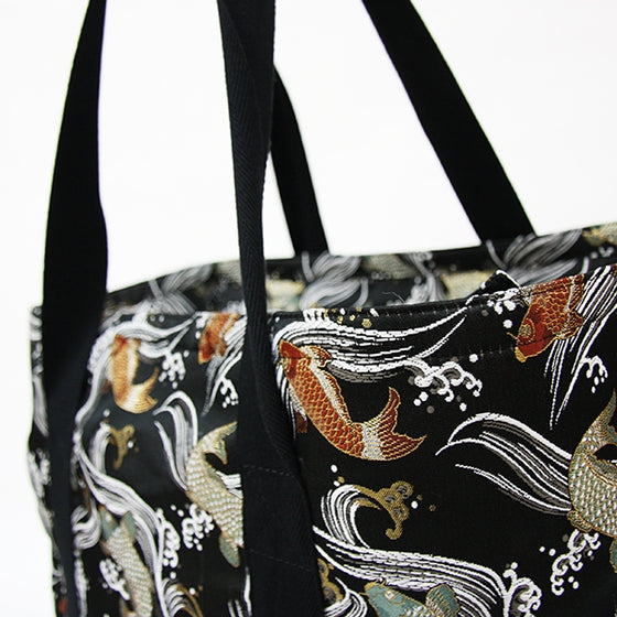 Close-up of the straps on the Koi themed brocade bag.