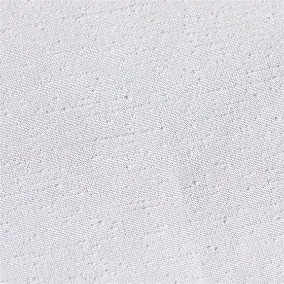 Close-up of the white version of the tsumugi polyester fabric.