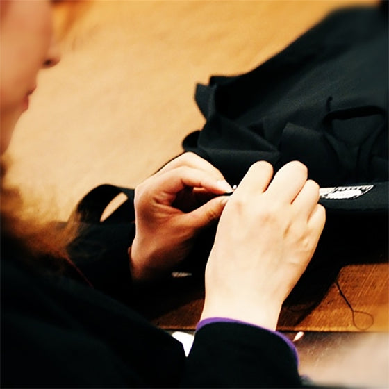 Close-up of one of our heian tailors at work.