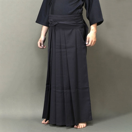 A pair of tailored kendo hakama worn.