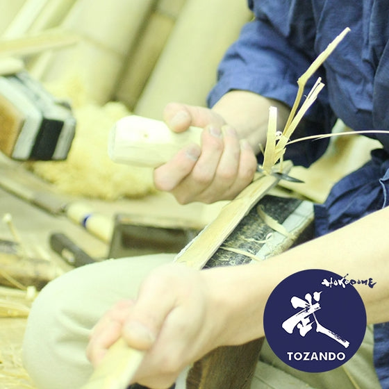 One of our craftsmen making a custom shinai.