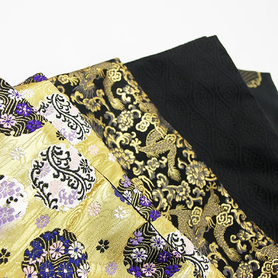 A selection of brocade fabrics seen enxt to each other.