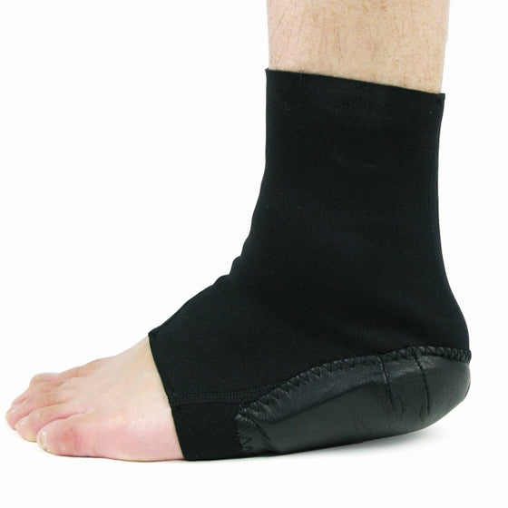 The heel protector shown worn, foot flat on the ground.