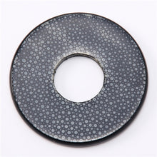 Full view of the black colored polished same tsuba.