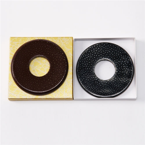 The brown (left) and black (right) same tsuba side by side.