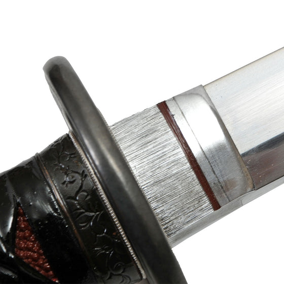 Close-up of the customised and laquered silver shonai habaki.