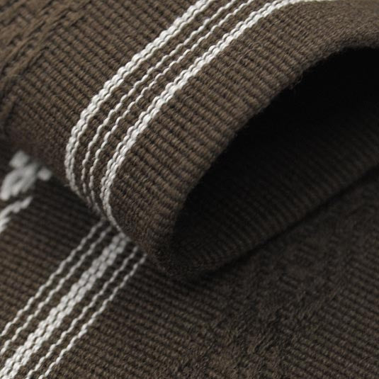 Close-up of the brown obi's hem.