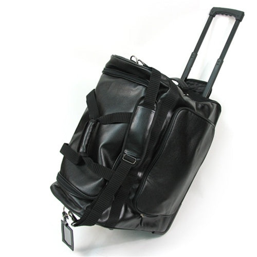 Full view of the traveller bogu bag with the handle extended.