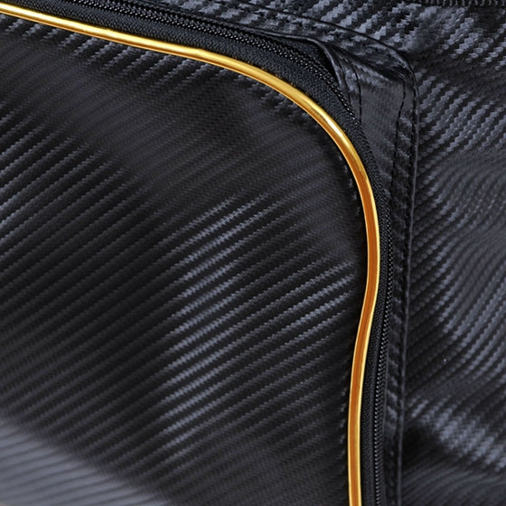 Close-up of the front pocket zip and gold trim.