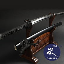 Tensho koshirae on a rack, outside of its saya.