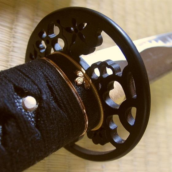 The sakura fuchi fitting and tsuba seen from the ura side.