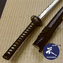 Iaito taken out of the saya, focussed on the tsuka.