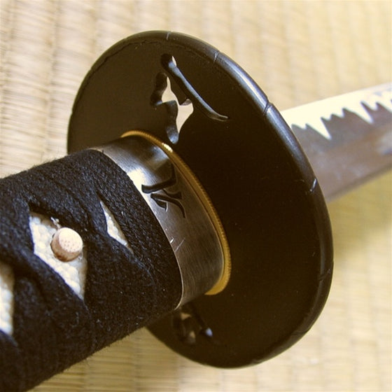 View from the ura side of the bonji themed fuchi and tsuba.