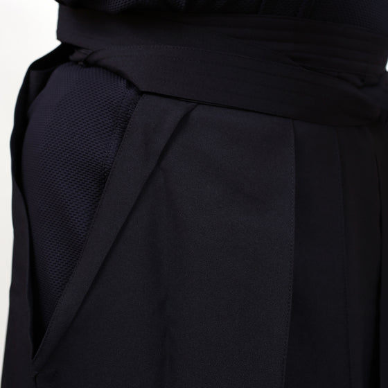 Dogi and hakama fabric side-by-side close-up.
