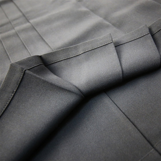 A view of the inner side of the lower hem and pleats.
