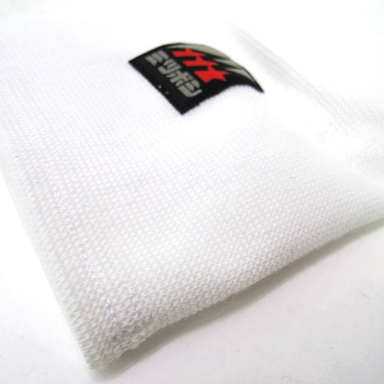 Close-up of the stretchy white fabric.
