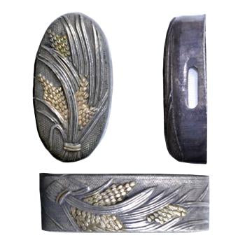 These copper fuchi and kashira are plated in silver with ears of rice gilded in gold.