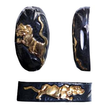 Tiger themed fuchi and kashira made from blackened brass.
