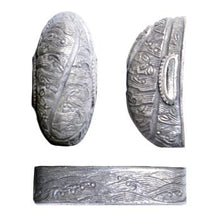 Silver-plated brass fittings that depict crashing white waves in the higo style.