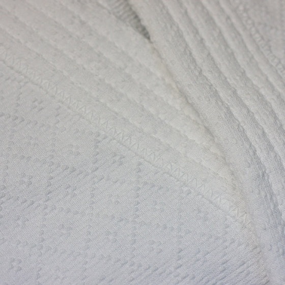 Close-up of the cotton fabric pattern.