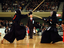 A view of kendo shiai with a referee.