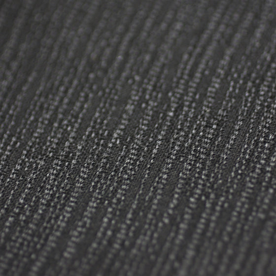 Super close-up of the fine wave patterns on the fabric.