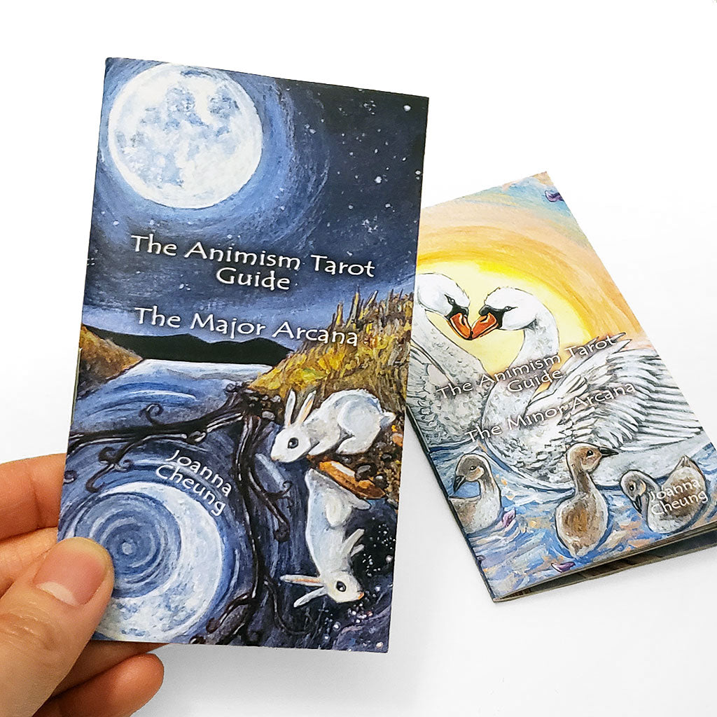 Two Animism Tarot guide booklets, covering the Major Arcana, and Minor Arcana.